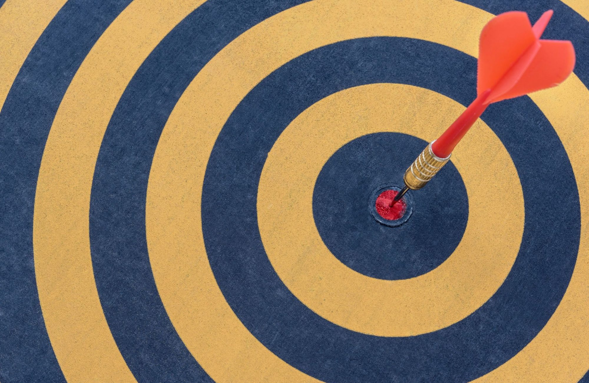 Dart target with arrow on bullseye, Goal target success business investment financial strategy concept, abstract background